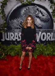 Camilla Belle chose an Andrew Gn cocktail dress in black with magenta and purple embellishments for the 'Jurassic World' premiere.
