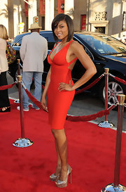 "Taraji rocked the bandage dress in a red V-neck style at the 'Larry Crowne' premiere. Taraji once told StyleBistro that these dresses are ""like a dress and a spanx in one!"""