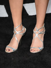 Denise Vasi chose silver strappy sandals for a sleek and contemporary look at the premiere of 'Oblivion.'