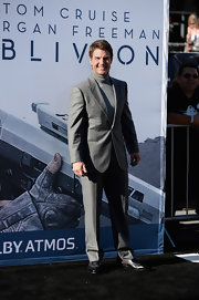Tom Cruise looked sleek and dapper in a gray suit with a matching gray turtleneck.