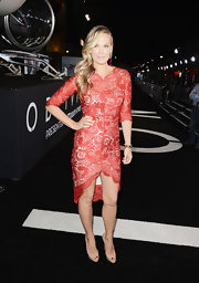Molly Sims dazzled in a red lace frock with a high-low hem and three-quarter-length sleeves.