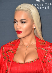 Rita Ora accentuated her eyes with a heavy application of neutral-toned shadow.