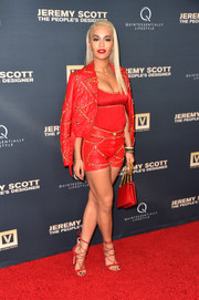 Rita Ora pulled her all-red ensemble together with a pair of Stuart Weitzman Legwrap sandals.