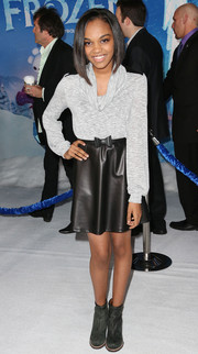 China McClain attended the premiere of 'Frozen' wearing a gray cowl-neck top.