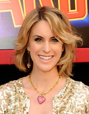 Cheryl Dent paired her sequined top with a gold and pink pendant necklace.