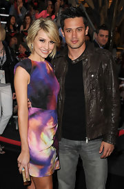 Chelsea Kane teamed her multicolored frock with a gold mirrored acrylic box clutch.