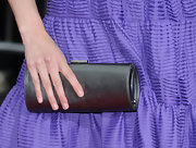 Krysten Ritter paired her purple strapless dress with a classic metallic silver buckled clutch.