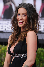 "Singer Alanis Morissette made a rare appearance at the ""Prince of Persia"" premiere where she showed off her signature wavy textured locks."