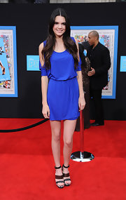 Kendall Jenner wore knockout brown and gray triple strap platforms with her bright blue dress.