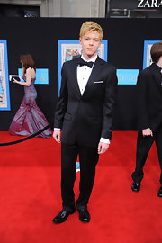 Cameron Monaghan wore a sleek black tuxedo to the 'Prom' premiere.