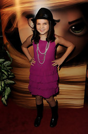 Bailee Madison arrived at the premiere of 'Tangled' wearing a pink ruffled dress.