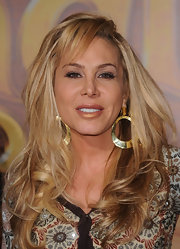 Adrienne Maloof boldly accessorized with a huge pair of dangling gold hoops at the premiere of 'Tangled.'