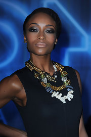Yaya DaCosta paired her nude lip with a silver, smoky eye. She heightened the drama by lining her lower lid in the same shade.