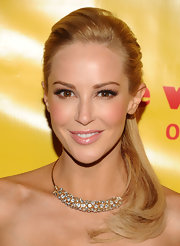 Louise Linton stepped out to the premiere of 'She Wants Me' wearing a pair of flirty false lashes.