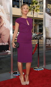 Christina paired her vibrant purple cocktail dress with nude suede platform pumps.