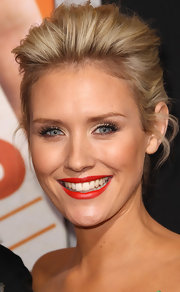 Nicky Whelan amped up her look with bright red lipstick.