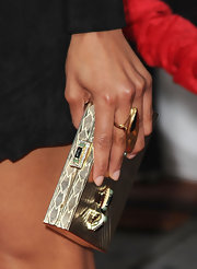 Zoe carried a stunning gold hard case clutch with stone and crystal embellishments.