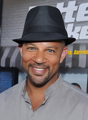 Chris Williams competed his red carpet look with a black fedora hat.