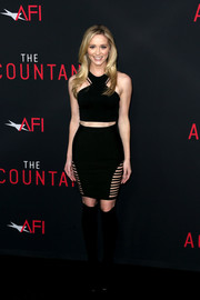 Greer Grammer completed her seductive look with a black cutout mini skirt.