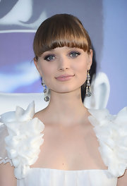 Bella Heathcote hit the premiere of 'Dark Shadows' with her silky tresses styled in a classic bun with brow-grazing bangs.