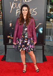 Jillian Rose Reed teamed a purple leather jacket with a floral frock for a tough-meets-sweet vibe at the premiere of 'We Are Your Friends.'