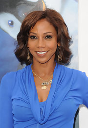 Holly Robinson Peete wore her shiny tresses with causal waves and side-swept bangs at the premiere of 'Happy Feet Two.'