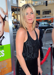 It seems like our favorite 'Friend' can never go wrong when it comes to hair! Jennifer Aniston looked classic and polished at the 'Horrible Bosses' premiere with signature sleek and straight hair.
