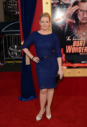 Melissa Joan Hart opted for a figure-flattering blue cocktail dress with bow belt for her feminine red carpet look.