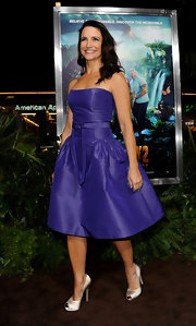 Kristin David accessorized her purple cocktail dress with silver satin peep-toe pumps.