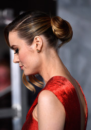 Brie Larson looked elegant at the 'Kong: Skull Island' premiere wearing this loose bun with wavy tendrils hanging down one side of her face.
