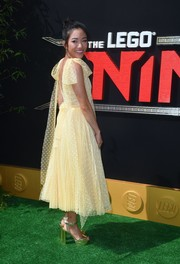 Constance Wu paired her dress with chunky gold platforms by Stuart Weitzman.