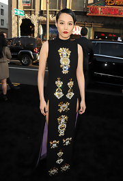 Rinko Kikuchi rocked a high-neck, sleeveless dress that featured two thigh-high leg slits and bold embellishing.