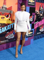 Tiffany Haddish teamed her sexy dress with silver platform sandals.