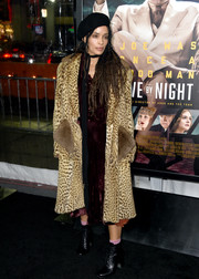Lisa Bonet styled her outfit with black lace-up boots.