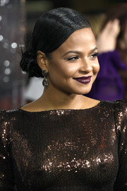 Christina Milian wore her hair in a twisted bun at the premiere of 'Live by Night.'