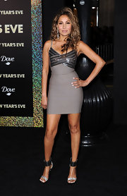 Wedil David paired her figure-flattering frock with metallic strappy sandals.