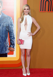 Greer Grammer accessorized with a pink box clutch for a splash of color.