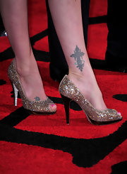 Virginia Madsen walked the red carpet where she showed off her decorative cross tattoo on her ankle.