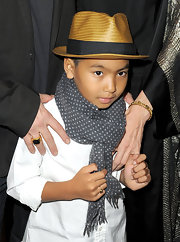 Maddox learned this style tip from his dad... don a dapper fedora!