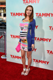 Eva Amurri Martino topped off her colorful outfit with a neon-pink leather clutch.