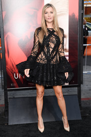 Joanna Krupa turned up the heat in a sheer black skater dress by Walter Collection at the premiere of 'Unforgettable.'