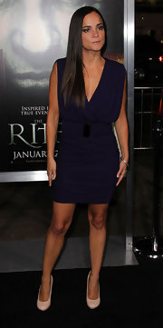 Alice wears a deep plum cocktail dress with a low plunging neckline for 'The Rite' premiere.