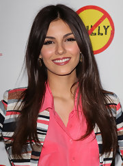 Victoria Justice attended the premiere of 'Bully' wearing her ultra-shiny tresses long and straight.