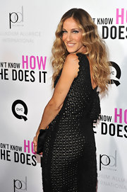 Sarah Jessica Parker wore her waves more smoothly than normal to the premiere of 'I Don't Know How She Does It'. To recreate her look, section slightly damp hair into two sides and loosely braid, securing ends with a hair elastic. Allow tresses to dry fully, unbraid, brush thoroughly and use an iron to add additional curls as needed.
