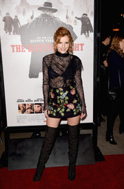 Bella Thorne flashed some skin in a sheer black lace blouse by Topshop at the premiere of 'The Hateful Eight.'