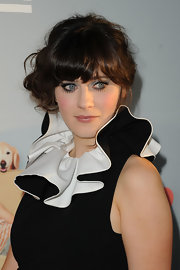 Zooey Deschanel added glamor to her whimsical ensemble with a messy side swept updo.