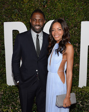 Naomie Harris paired her cutout dress with a gray Burberry clutch when she attended the 'Mandela: Long Walk to Freedom' Hollywood premiere.