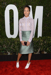 Cush Jumbo sealed off her look with a pair of white peep-toe booties.