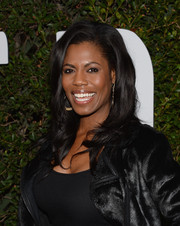 Omarosa Manigault styled her hair with pretty waves for the 'Mandela: Long Walk to Freedom' Hollywood premiere.