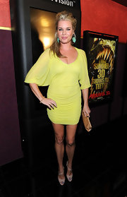 Actress Rebecca Romijn attended the premiere of 'Pirhana 3D' wearing a rose gold Valencia bracelet.